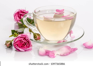 Glass cup of Tea with roses and petals