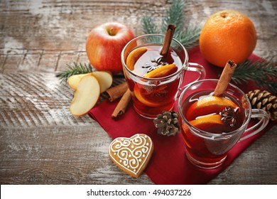 Glass cups of delicious Christmas mulled wine on napkin