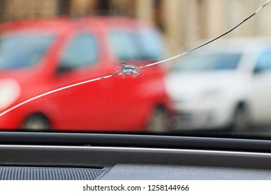 Glass damage from stone chips in the windscreen