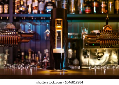 Glass of dark beer.