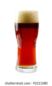 Glass of dark beer isolated on a white background
