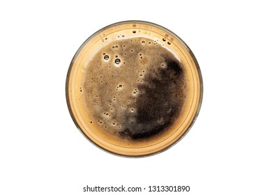 Glass of dark beer, top view with creamy froth - isolated on white