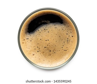 Glass of dark stout beer top view with foam. Isolated on white background. with clipping path.