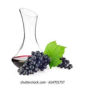 Glass decanter with red organic wine, blue grapes and green leaf, isolated on white background.