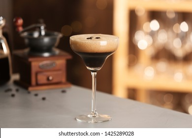 Glass of delicious Espresso Martini on bar counter. Alcohol cocktail