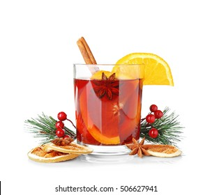 Glass of delicious mulled wine with Christmas decor on white background