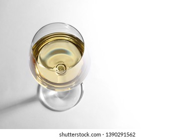 Glass of delicious wine on white background, above view