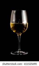 A glass with desert wine on a black background.