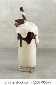 glass of dessert of frozen banana and coconut ice cream decorated with chocolate
