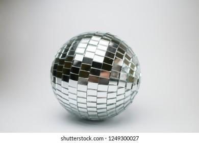 glass disco ball. Silver disco mirror ball isolated on white background. Disco ball closeup isolated on white background. Shiny disco ball white.