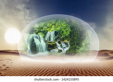 Glass dome with natural scenery and waterfalls in a desert landscape
