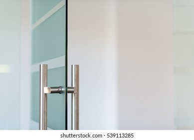 Glass door with metal handle