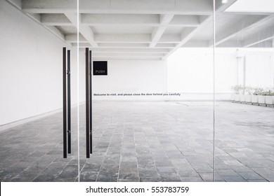 Glass door with welcome wording in the building