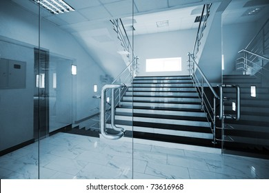 Glass doors with a kind on a marble staircase