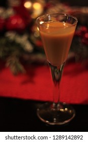 A glass of egg liqueur on the table. Advocaat or advocatenborrel, a traditional Dutch alcoholic beverage made from eggs, sugar, and brandy.