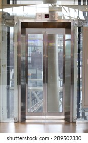 Glass elevator door,  Businessman taking modern glass elevator to the upper floors, high building office and shopping mall and hotel, transportation