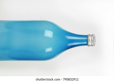 Glass empty bottle with screw cap.