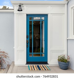 Glass Entry Door. Front door in Lively Blue with framed glass an