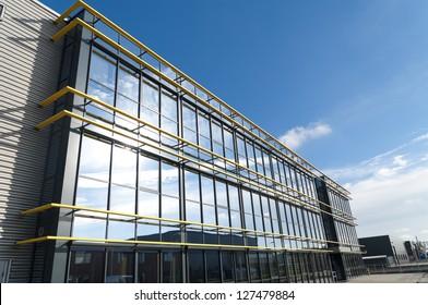 glass exterior of a modern office building