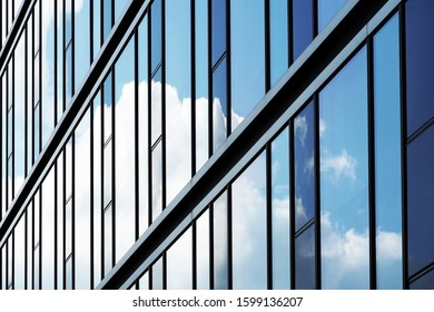 Glass facade with cloud reflection in the windows