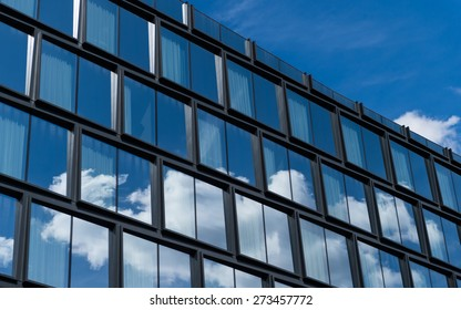 Glass facade with clouds