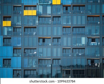 Glass facade of high-density residential apartments. Windows and balconies on high rise modern building. City of Melbourne, VIC Australia.
