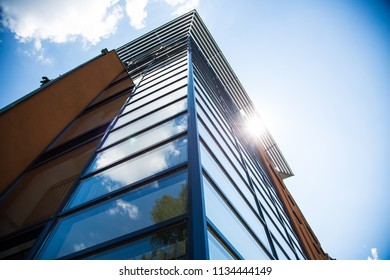 Glass facade in the sunshine, from bottom to top