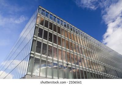 Glass faced office building against autumn sky