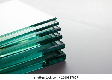 Glass factories produce glass used in buildings and homes. There are many different thicknesses and sizes.