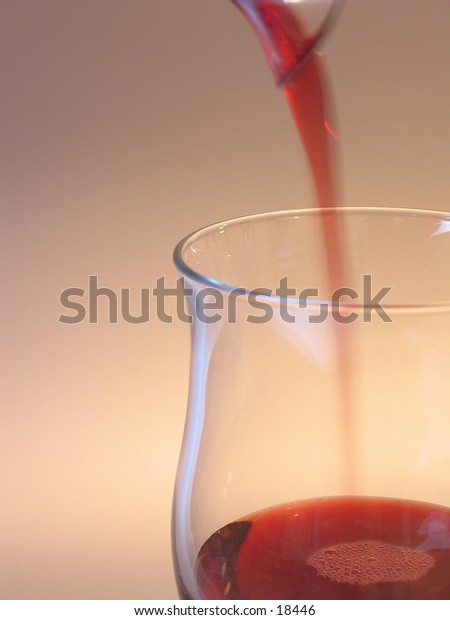 A glass filled with red wine.