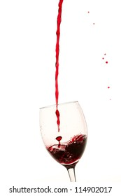 Glass filled with a red wine on white background