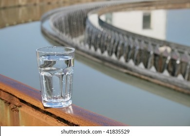 glass filled with water after standing near the treatment plant