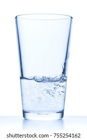 glass filled with water on white background
