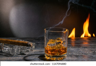 a glass of fire fired on a cigar glass