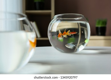Glass fishbowls on table
