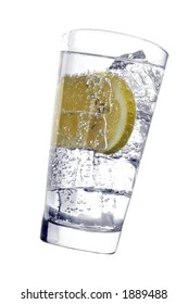 Glass with fizzy liquid and lemon slice