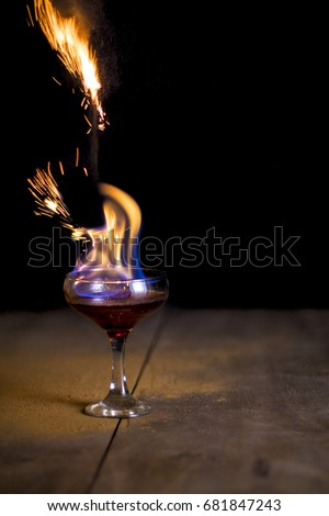 Glass of flaming cocktail