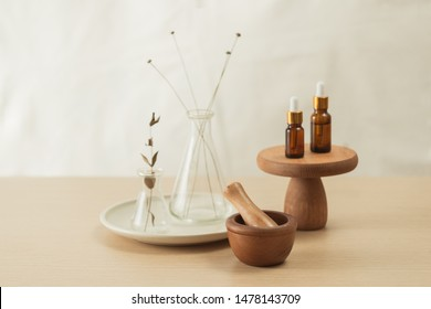 Glass flask and test tubes with flowers for medical health or cosmetic science research laboratory