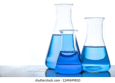 Glass flasks with blue fluid in used in chemistry experiments