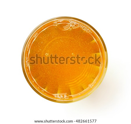 glass of fresh apple juice isolated on white background, top view