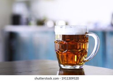 Glass of fresh beer on a wooden table. Lager beer mug on stone table. Top view copy space - Shutterstock ID 1911309520