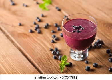 Glass of fresh blueberry smoothie with blueberries