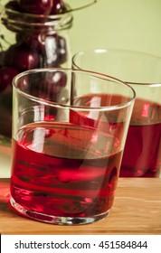 glass of fresh cherry juice and fresh cherries