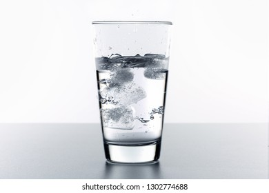 A glass of fresh clean water with ice