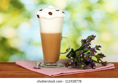 glass of fresh coffee cocktail on bright green background