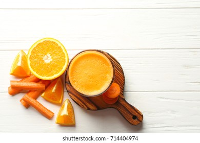 Glass with fresh juice  and ingredients on wooden table