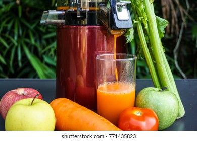 A glass of fresh juice from organic fruits and vegetables. Slow juicer.