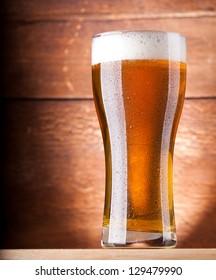 glass of fresh light beer