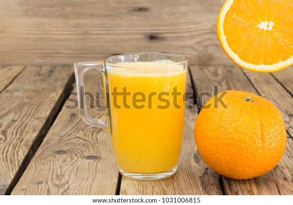 Glass with fresh orange juice, mediterranean breakfast