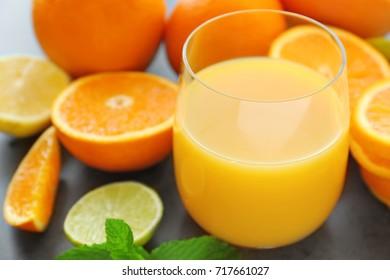 Glass of fresh orange juice on table, closeup